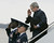 President Bush, carrying his dog Barney, salutes airmen as he disembarks Air Force One at Andrews Air Force Base, Md., after returning from Cincinnati, Ohio, Monday, April 3, 2006. (AP Photo/Charles Dharapak)