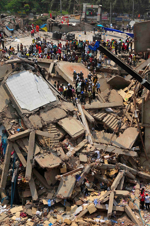 Description of . Rescue workers continue their operations at collapsed Rana Plaza building in Savar, 30 km (19 miles) outside Dhaka April 25, 2013. REUTERS/Stringer