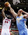 Detroit Pistons forward Jason Maxiell (54) shoots against Denver Nuggets center Kosta Koufos (41) in the first half of an NBA basketball game, Tuesday, Dec. 11, 2012, in Auburn Hills, Mich. (AP Photo/Duane Burleson)
