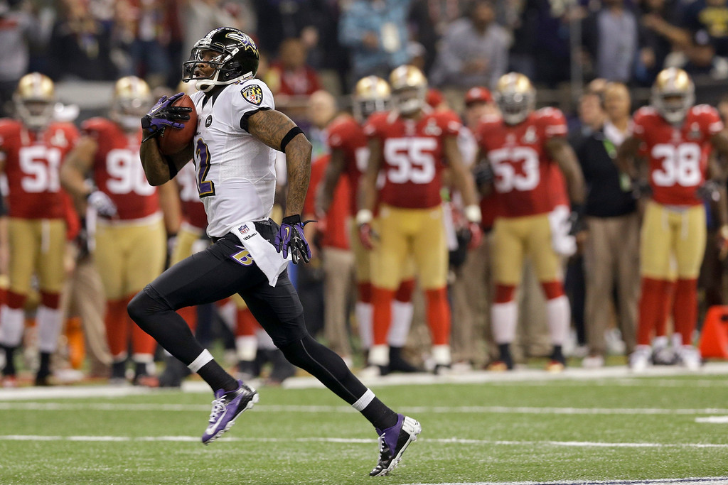 Description of . Baltimore Ravens wide receiver Jacoby Jones (12) runs the second-half opening kickoff back for a touchdown against the San Francisco 49ers in the NFL Super Bowl XLVII football game, Sunday, Feb. 3, 2013, in New Orleans. (AP Photo/Patrick Semansky)