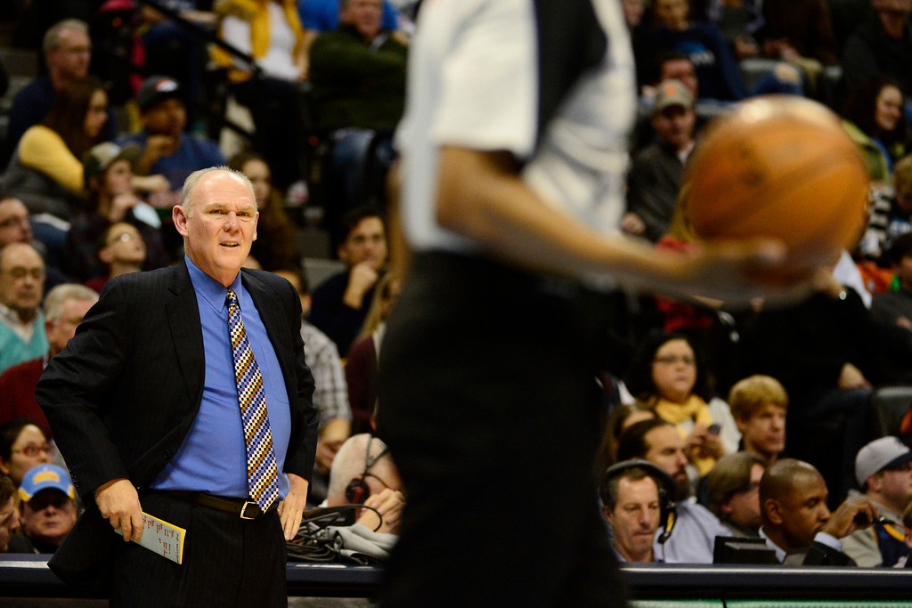 Description of . Denver Nuggets head coach George Karl is upset by a call against his team during the first half at the Pepsi Center on Sunday, January 13, 2013. AAron Ontiveroz, The Denver Post