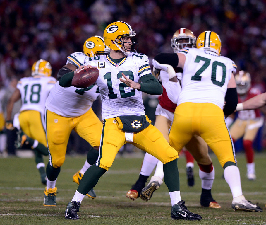 Description of . Green Bay Packers quarterback Aaron Rodgers drops to pass against the San Francisco 49ers during the first quarter in the NFC Divisional Playoff on Saturday, January 12, 2013, at Candlestick Park in San Francisco, California. (Jose Carlos Fajardo/San Jose Mercury News)