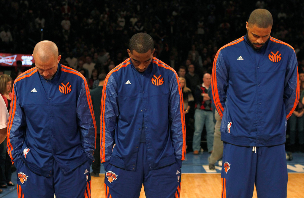 Description of . (L-R) New York Knicks Jason Kidd, J.R. Smith and Tyson Chandler observe a moment of silence, for the victims of a mass shooting at Sandy Hook Elementary School in Newtown, Connecticut, before taking on the Cleveland Cavaliers in their NBA basketball game at Madison Square Garden in New York, December 15, 2012. REUTERS/Adam Hunger