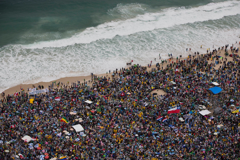 Description of . Participants of Word Youth Day gather on Copacabana beach in Rio de Janeiro, Brazil, Thursday, July 25, 2013. Francis will address young Roman Catholics on Copacabana beach on Thursday, as Latin America's first pope continues his inaugural international trip as pontiff. (AP Photo/Felipe Dana)