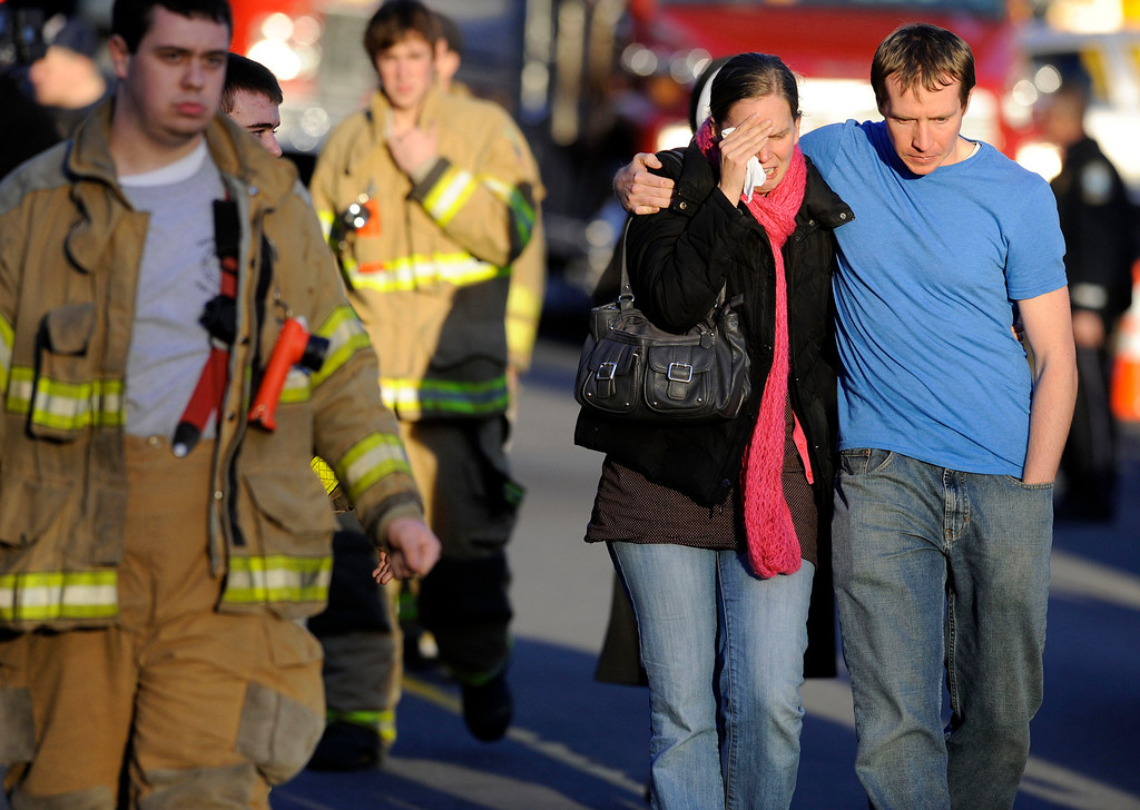 Description of . Victims family leave a firehouse staging area following a shooting at the Sandy Hook Elementary School in Newtown, Conn., about 60 miles (96 kilometers) northeast of New York City, Friday, Dec. 14, 2012. An official with knowledge of Friday's shooting said 27 people were dead, including 18 children.  (AP Photo/Jessica Hill)