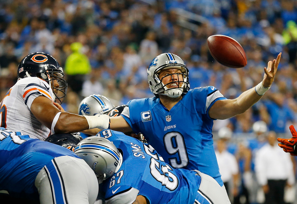 Description of . Detroit Lions quarterback Matthew Stafford (9) reaches out to recover his own fumble, and score as he crossed the goal line during the second quarter of an NFL football game against the Chicago Bears at Ford Field in Detroit, Sunday, Sept. 29, 2013. (AP Photo/Paul Sancya)