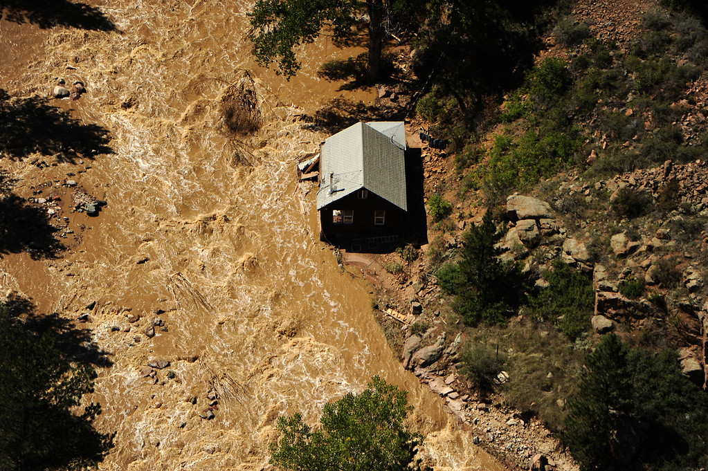 Description of . Flood damage as seen from a UH-60 Black Hawk during search grid flights of the foothills west of Boulder by members of the 2-4 GSAB with the 4th ID of Fort Carson September 17, 2013 Boulder, CO. (Photo By Joe Amon/The Denver Post)