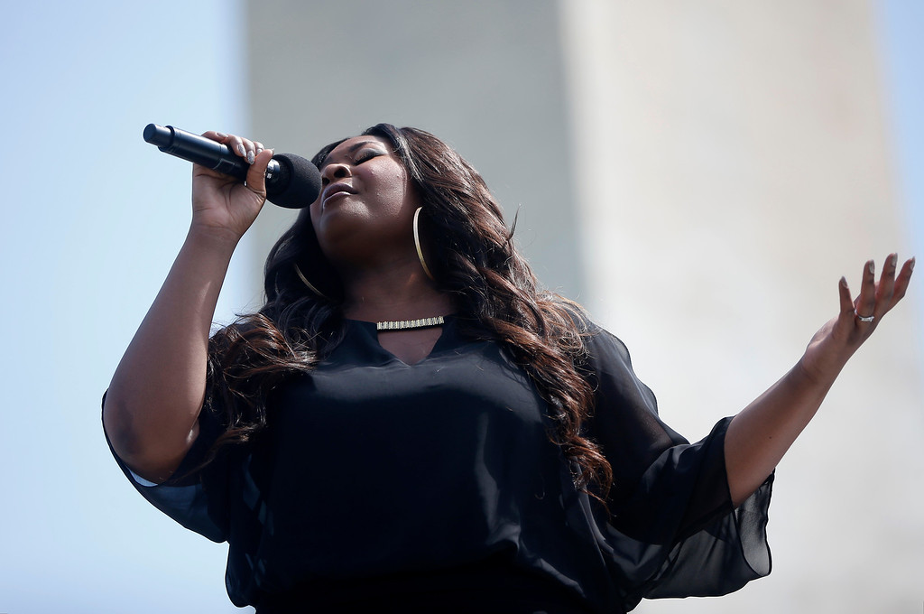 . Candice Glover, 2013 American Idol winner, sings at the Washington Monument in Washington, May 12, 2014, at a ceremony to celebrate its re-opening.  (AP Photo)