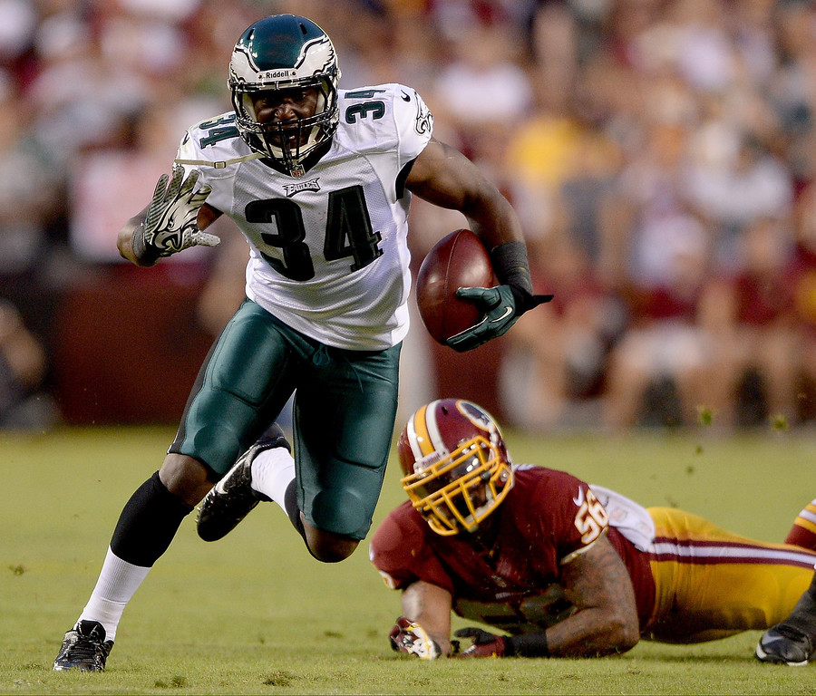 Description of . Running back Bryce Brown #34 of the Philadelphia Eagles runs the ball in the first half against nose tackle Barry Cofield #96 of the Washington Redskins at FedExField on September 9, 2013 in Landover, Maryland.  (Photo by Patrick Smith/Getty Images)