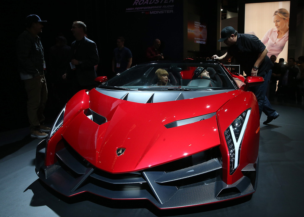 Description of . The Lamborghini Veneno Roadster outfitted with Monster Audio is displayed in the Monster booth at the 2014 International CES at the Las Vegas Convention Center on January 8, 2014 in Las Vegas, Nevada. CES, the world's largest annual consumer technology trade show, runs through January 10 and is expected to feature 3,200 exhibitors showing off their latest products and services to about 150,000 attendees.  (Photo by Justin Sullivan/Getty Images)