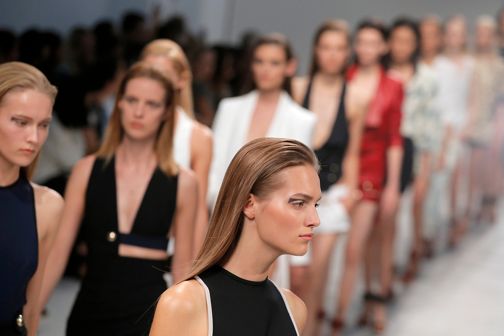 Description of . Models present creations as part of Italian fashion designer Anthony Vaccarello's ready-to-wear Spring/Summer 2014 fashion collection presented in Paris, Tuesday, Sept. 24, 2013. (AP Photo/Christophe Ena)