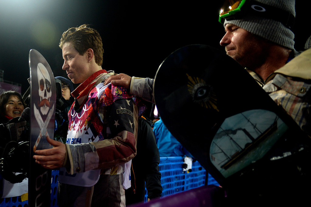 Description of . Shaun White reacts as longtime trainer Bud Keene places a hand on his shoulder after the two-time defending gold medalist finished fourth in the men\'s snowboard halfpipe final. Sochi 2014 Winter Olympics on Tuesday, February 11, 2014. (Photo by AAron Ontiveroz/The Denver Post)