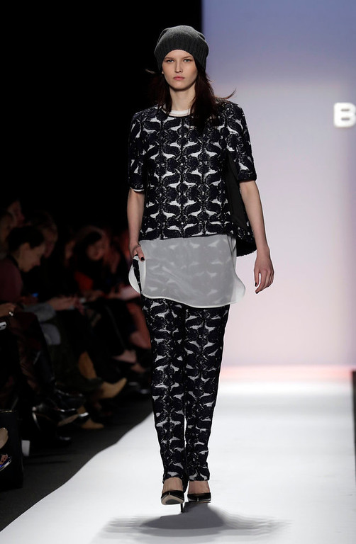 Description of . The BCBG Max Azria Fall 2013 collection is modeled during Fashion Week in New York on Thursday, Feb. 7, 2013. (AP Photo/Richard Drew)