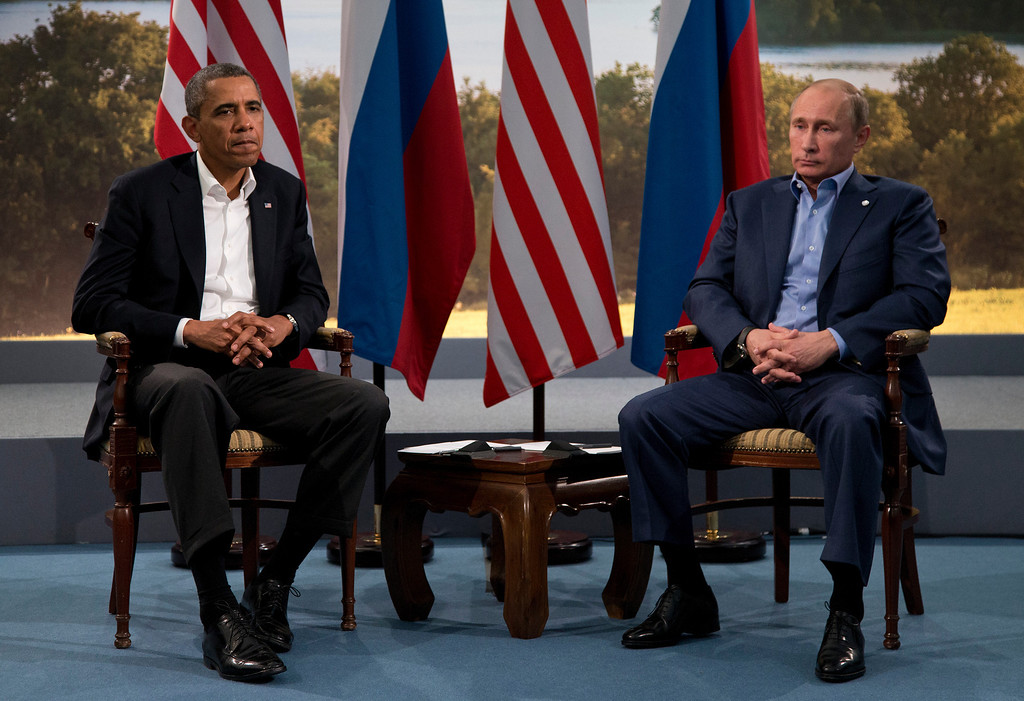 Description of . President Barack Obama meets with Russian President Vladimir Putin in Enniskillen, Northern Ireland, Monday, June 17, 2013. Obama and Putin discussed the ongoing conflict in Syria during their bilateral meeting. (AP Photo/Evan Vucci, File)
