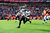 Baltimore Ravens cornerback Corey Graham (24) returns an interception for a touchdown in the first quarter. The Denver Broncos vs Baltimore Ravens AFC Divisional playoff game at Sports Authority Field Saturday January 12, 2013. (Photo by AAron  Ontiveroz,/The Denver Post)