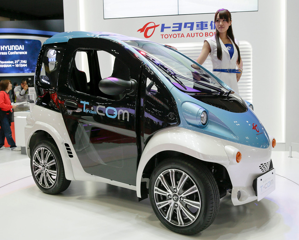 Description of . Toyota Auto Body unveils its super compact electric vehicle COMS at the 43rd Tokyo Motor Show 2013 in Tokyo, Japan, 20 November 2013. EPA/KIMIMASA MAYAMA