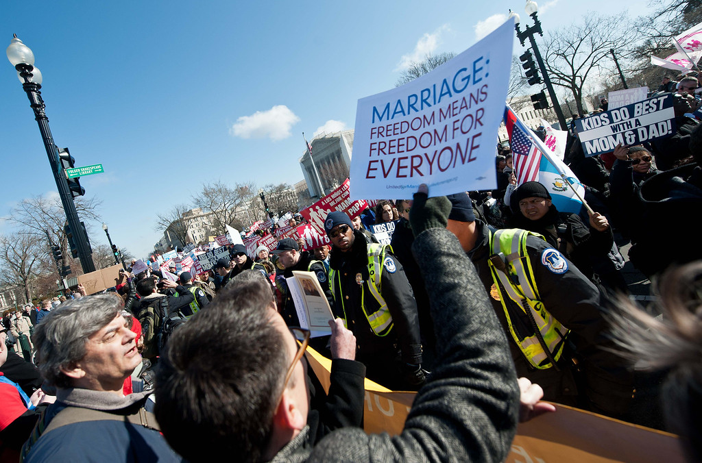 Description of . Opponents and supporters of same-sex marriage converge in front of the US Supreme Court as the March for Marriage arrives at the court in Washington,DC on March 26, 2013. AFP PHOTO/Nicholas  KAMM/AFP/Getty Images