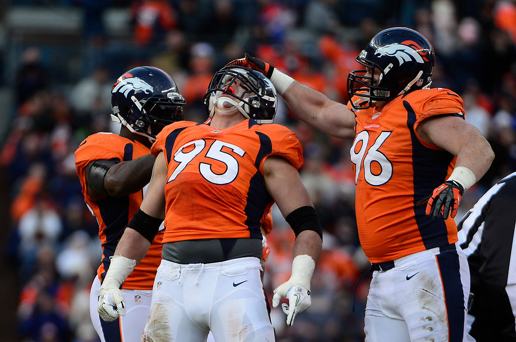 Description of . Denver Broncos defensive end Derek Wolfe (95) and Denver Broncos defensive tackle Mitch Unrein (96) celebrates a sack in the second quarter as the Denver Broncos took on the Kansas City Chiefs at Sports Authority Field at Mile High in Denver, Colorado on December 30, 2012. AAron Ontiveroz, The Denver Post