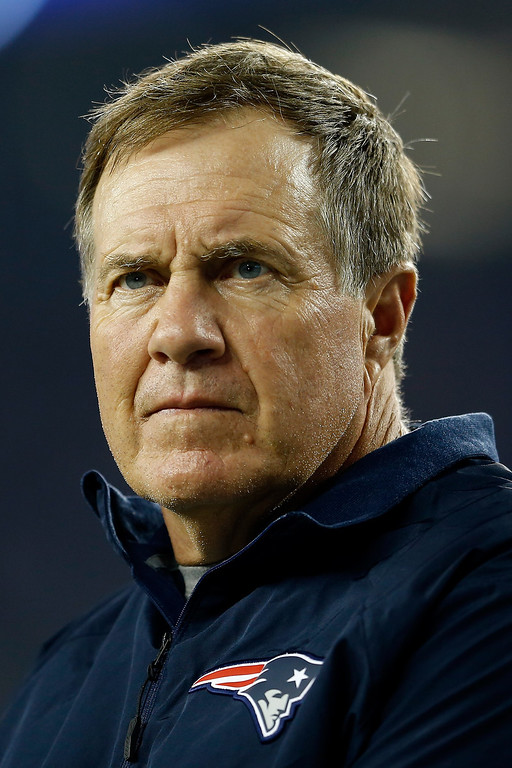 Description of . Head coach Bill Belichick of the New England Patriots looks on before the Patriots take on the New York Jets at Gillette Stadium on September 12, 2013 in Foxboro, Massachusetts.  (Photo by Jim Rogash/Getty Images)