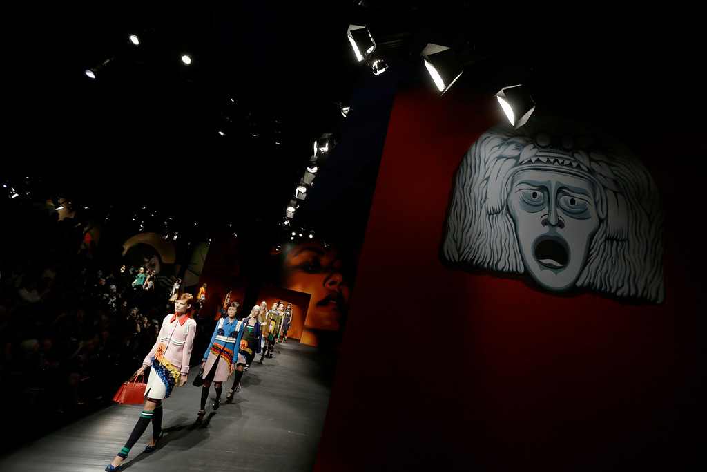 Description of . Models wear creations for Prada's women's Spring-Summer 2014 collection, part of the Milan Fashion Week, unveiled in Milan, Italy, Thursday, Sept. 19, 2013. (AP Photo/Luca Bruno)