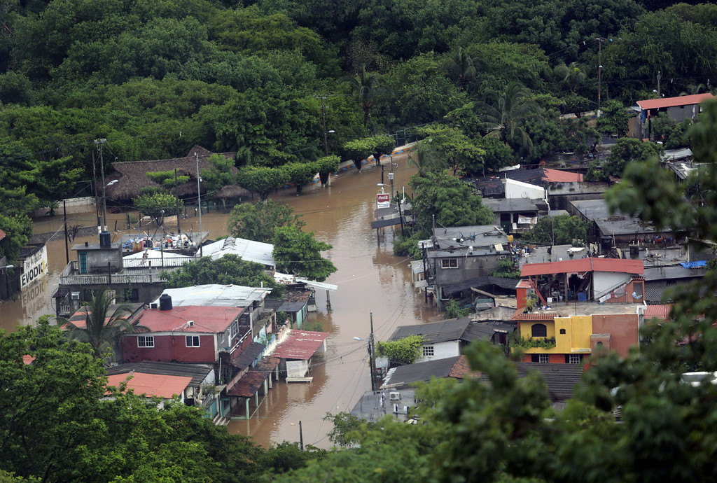 Description of . View of the flooded area in Puerto Marques in Acapulco, Guerrero state, Mexico, after heavy rains hit the area on September 16, 2013. Hurricane Ingrid weakened to tropical storm strength as it made landfall on the northeastern coast in the morning while the Pacific coast was reeling from the remnants of Tropical Storm Manuel, which dissipated after striking on the eve. Thousands of people were evacuated on both sides of the country as the two storms set off landslides and floods that damaged bridges, roads and homes.   Pedro PARDO/AFP/Getty Images