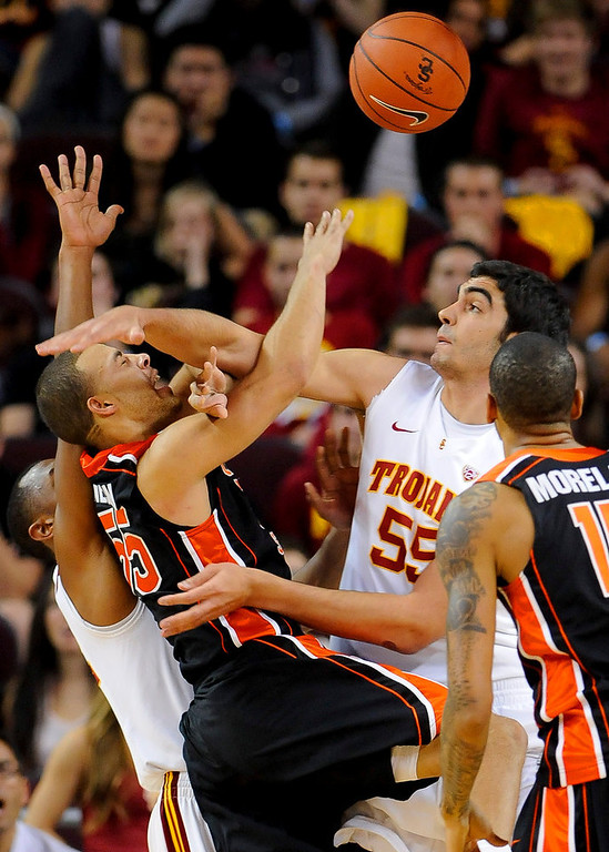 Description of . Southern Cal center Omar Oraby (55) and guard Byron Wesley, back left, double team Oregon State guard Roberto Nelson (55) and stop him from scoring during the second half of an NCAA college basketball game, Saturday, Jan. 19, 2013, in Los Angeles. Southern Cal won 69-68. (AP Photo/Gus Ruelas)