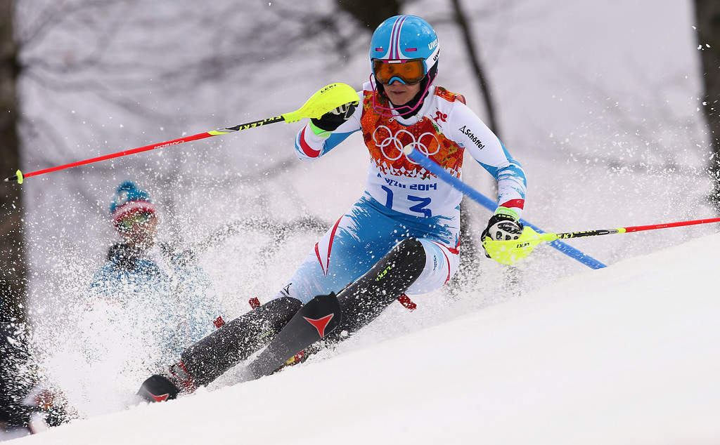 Description of . Austria's Michaela Kirchgasser skis past a gate in the first run of the women's slalom at the Sochi 2014 Winter Olympics, Friday, Feb. 21, 2014, in Krasnaya Polyana, Russia. (AP Photo/Alessandro Trovati)