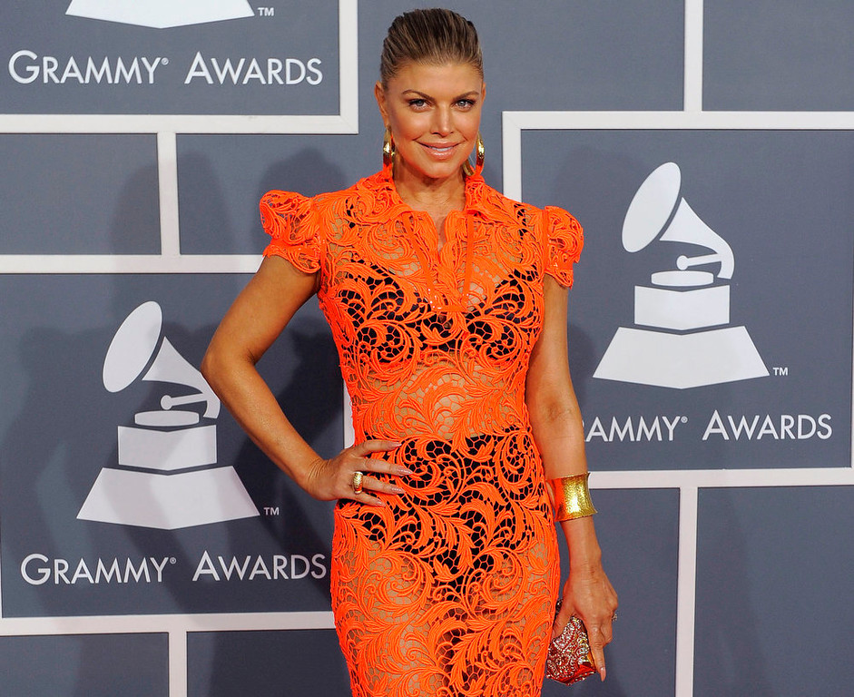 Description of . Fergie at the 54th annual Grammy Awards in Los Angeles. CBS has issued a memo to Grammy Awards attendees against baring too much skin at the ceremony Sunday. The network requests that 'buttocks and female breasts are adequately covered'' for the televised award show. The memo sent out Wednesday, Feb. 6, 2013, also warned against 'see-through clothing,' exposure of 'the genital region' and said that 'thong type costumes are problematic. (AP Photo/Chris Pizzello)