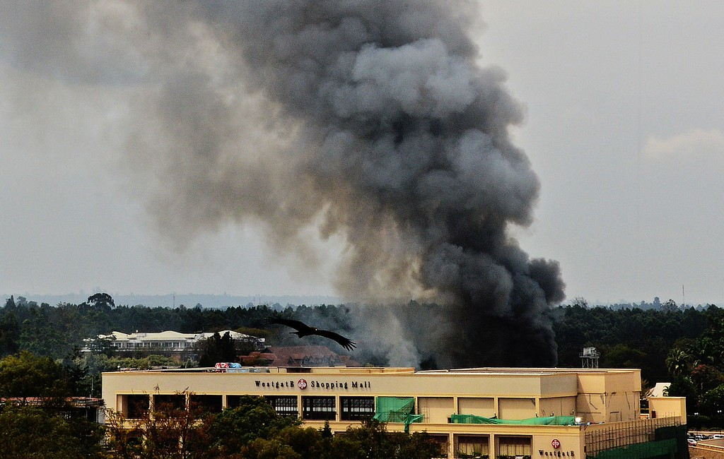 Description of . Smoke rises from the Westgate mall in Nairobi on September 23, 2013.  AFP PHOTO / CARL DE  SOUZA/AFP/Getty Images