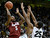 Stanford's Chasson Randle takes a shot over Jeremy Adams, center, and Spencer Dinwiddie, No. 25, during a game against the University of Colorado on Thursday, Jan. 24, at the Coors Event Center on the CU campus in Boulder. Jeremy Papasso/ Camera