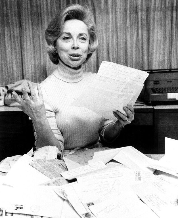 Description of . Psychologist Dr. Joyce Brothers displays flood of mail she received in wake of incident in which she saved the life of a Long Island housewife, who called during Dr. Brothers' radio program and threatened suicide on Jan. 8, 1971. Dr. Brothers held the woman on the phone until the call could be traced. (AP Photo/Marty Lederhandler )