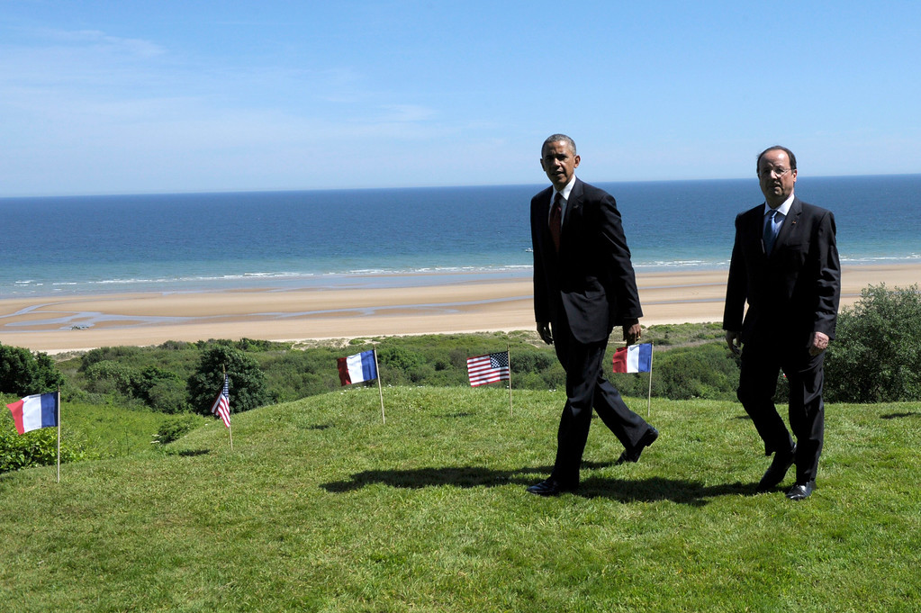 Description of . US President Barack Obama, left, and  French President Francois Hollande look out over Omaha beach during a joint French-US D-Day commemoration ceremony at the Normandy American Cemetery and Memorial in Colleville-sur-mer, Normandy, France, Friday June 6, 2014, marking the 70th anniversary of the World War II Allied landings in Normandy. (AP Photo/Alain Jocard, pool)