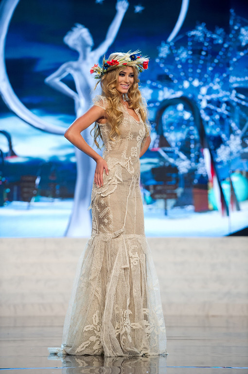 Description of . Miss Poland 2012, Marcelina Zawadzka, performs onstage at the 2012 Miss Universe National Costume Show on Friday, Dec. 14, 2012 at PH Live in Las Vegas, Nevada. The 89 Miss Universe Contestants will compete for the Diamond Nexus Crown on Dec. 19, 2012. (AP Photo/Miss Universe Organization L.P., LLLP)