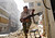 A Free Syrian Army fighter takes cover during clashes with Syrian Army in the Salaheddine neighbourhood of central Aleppo August 7, 2012.  REUTERS/Goran Tomasevic