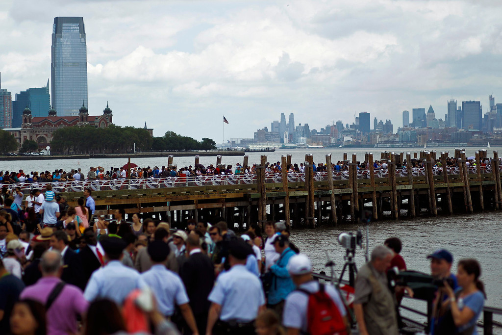 Description of . People arrive at the Statue of Liberty and Liberty Island during its reopening to the public in New York July 4, 2013. Under steamy summer skies, tourists in New York flocked to ferries headed for the Statue of Liberty, re-opening with an Independence Day ceremony after closing in October as Superstorm Sandy approached. REUTERS/Eduardo Munoz
