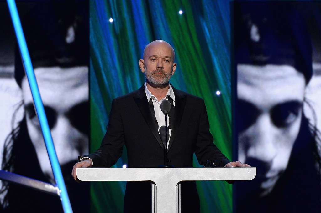 Description of . Musician Michael Stipe speaks onstage at the 29th Annual Rock And Roll Hall Of Fame Induction Ceremony at Barclays Center of Brooklyn on April 10, 2014 in New York City.  (Photo by Larry Busacca/Getty Images)