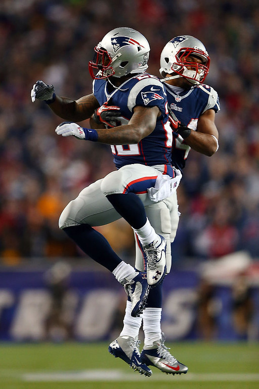Description of . Stevan Ridley #22 of the New England Patriots celebrates with Shane Vereen #34 after scoring a touchdown in the third quarter against the Houston Texans during the 2013 AFC Divisional Playoffs game at Gillette Stadium on January 13, 2013 in Foxboro, Massachusetts.  (Photo by Elsa/Getty Images)