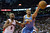 Denver Nuggets' Anthony Randolph reaches for the ball next to Toronto Raptors' John Lucas during the second half of an NBA basketball game in Toronto on Tuesday, Feb. 12, 2013. (AP Photo/The Canadian Press, Chris Young)