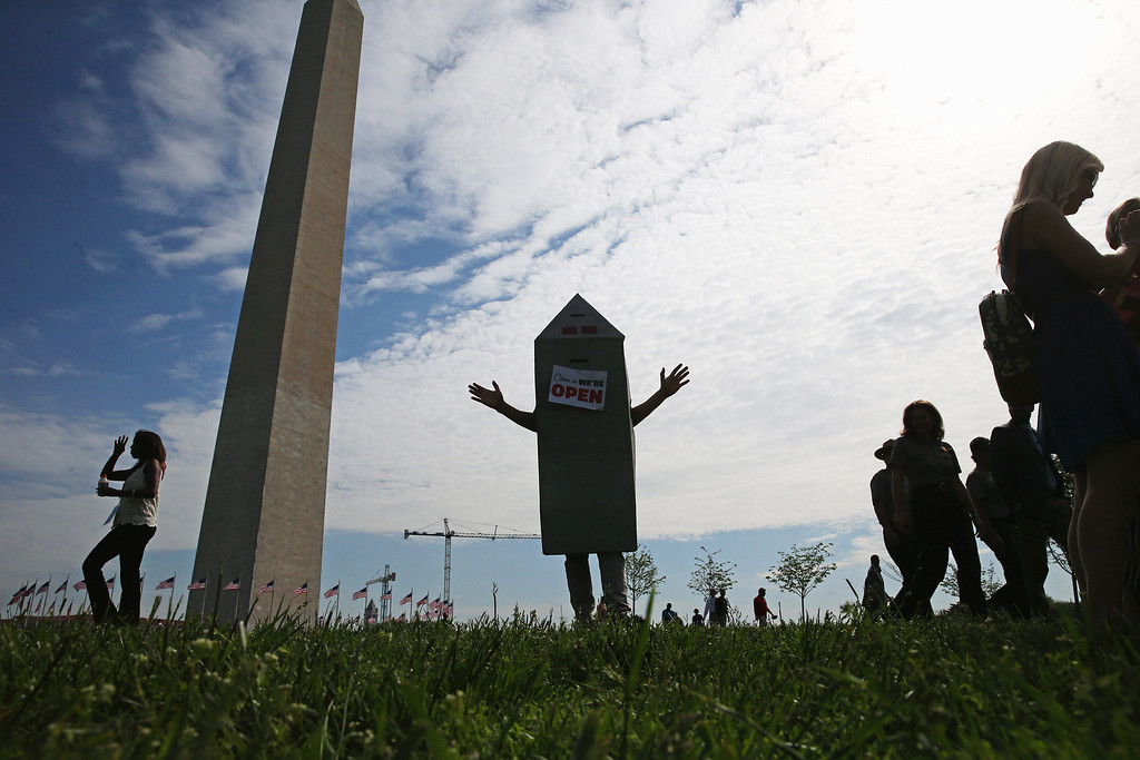 . Steven Avilla wears a Washington monument costume as he greets visitors to the monument,  May 12, 2014 on the ground of the monument in Washington, DC.   (Photo by Mark Wilson/Getty Images)