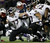 Baltimore Ravens running back Ray Rice (27) runs with the ball during the first half of the NFL football AFC Championship football game against the New England Patriots in Foxborough, Mass., Sunday, Jan. 20, 2013. (AP Photo/Elise Amendola)