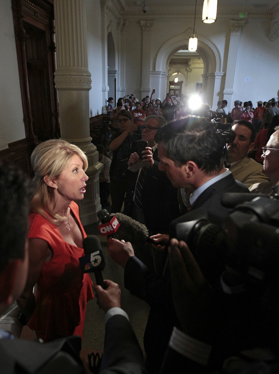 Description of . Sen. Wendy Davis, D-Ft. Worth is interviewed after the first day of the second legislative special session called by Gov. Rick Perry on July 1, 2013 in Austin, Texas. This is the first day of a second legislative special session called by Texas Gov. Rick Perry to pass a restrictive abortion law through the Texas legislature. The first attempt was defeated after opponents of the law were able to stall the vote until after first special session had ended.  (Photo by Erich Schlegel/Getty Images)