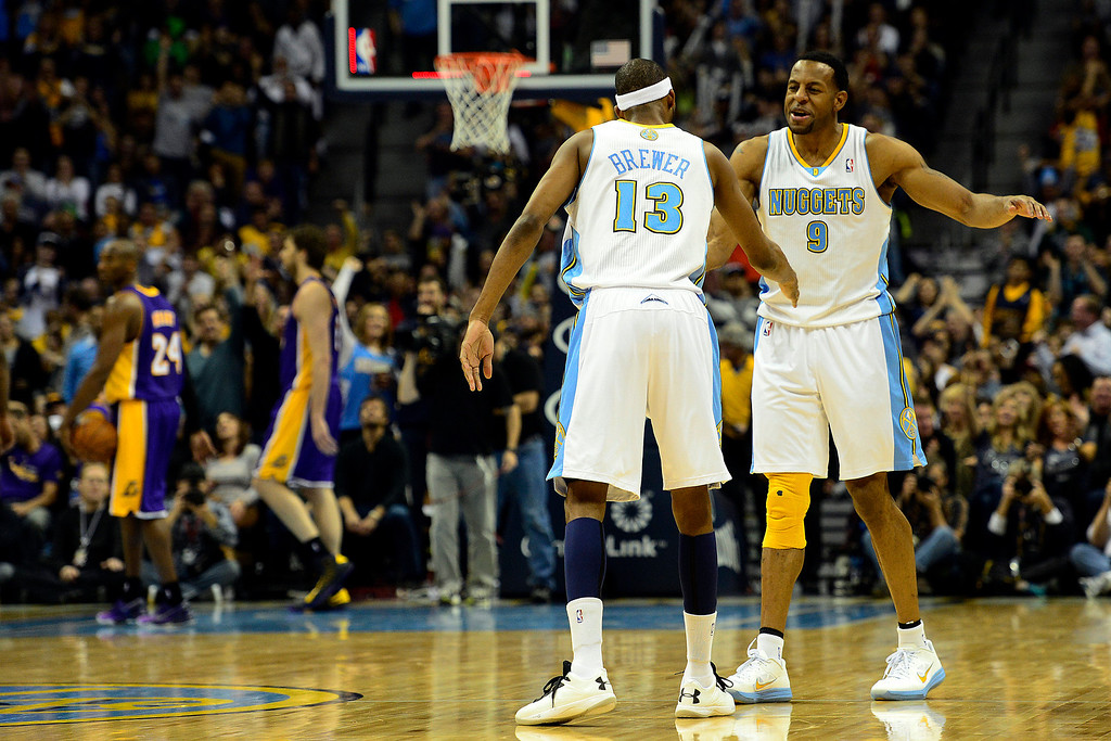 Description of . Denver Nuggets small forward Corey Brewer (13) celebrates a three pointer with shooting guard Andre Iguodala (9) against the Los Angeles Lakers during the second half of the Nuggets' 126-114 win at the Pepsi Center on Wednesday, December 26, 2012. AAron Ontiveroz, The Denver Post