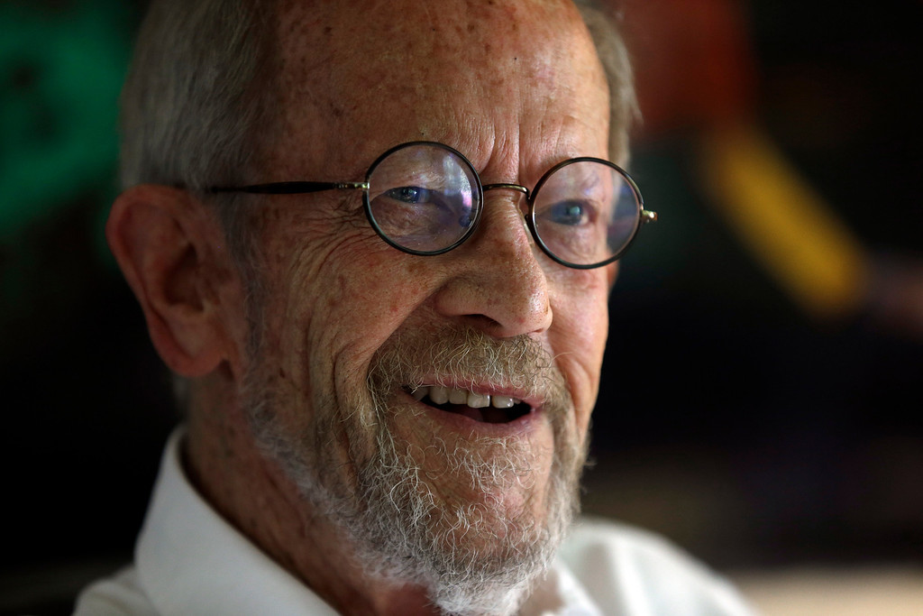 Description of . This Sept. 17, 2012 file photo shows author Elmore Leonard at his Bloomfield Township, Mich., home. Leonard, the crime novelist whose acclaimed best-sellers and the movies made from them, died Aug. 20, 2013 from complications from a stroke. He was 87. (AP Photo/Paul Sancya)