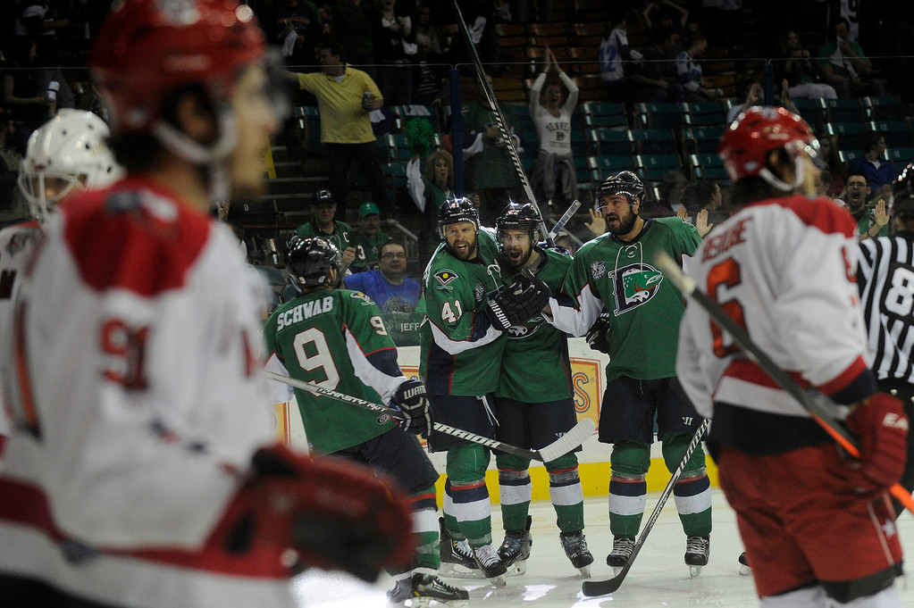 Description of . DENVER, CO - MAY 2: The Denver Cutthroats celebrate their fourth goal of the night during the third period of game 1 of the Ray Miron Presidents Cup Finals at the Denver Coliseum in Denver, Colorado on May 2, 2014. (Photo by Seth McConnell/The Denver Post)