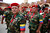 Venezuelan veteran paratroopers get ready before a military parade during the commemoration of the 21st anniversary of President Hugo Chavez's attempted coup d'etat in Caracas February 4, 2013. Venezuelan President Hugo Chavez is still in Cuba recovering from a cancer surgery and has not been seen in public since December 8 last year. REUTERS/Jorge Silva