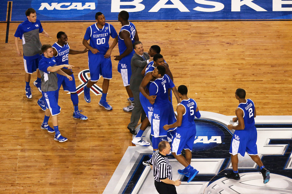 Description of . ARLINGTON, TX - APRIL 05:  The Kentucky Wildcats celebrate after defeating the Wisconsin Badgers 74-73 in the NCAA Men's Final Four Semifinal at AT&T Stadium on April 5, 2014 in Arlington, Texas.  (Photo by Ronald Martinez/Getty Images)
