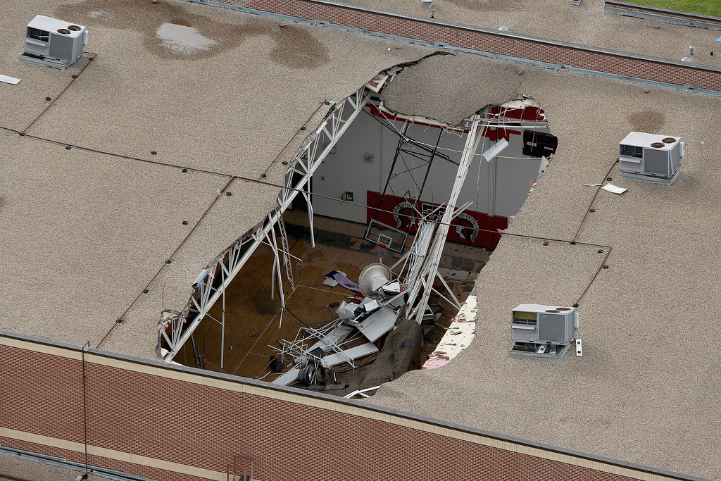 Description of . WEST, TX - APRIL 18:  A giant hole in the ceiling of the West High School gymnasium shows where an explosion at the West Fertilizer Company a day earlier launched debris through the roof April 18, 2013 in West, Texas. According to West Mayor Tommy Muska, around 35 people, including 10 first responders, were killed and more than 150 people were injured when the fertilizer company caught fire and exploded, leaving damaged buildings for blocks in every direction.  (Photo by Chip Somodevilla/Getty Images)