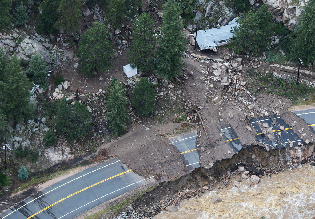 Description of . A home still stands, but is heavily damaged from a landslide along Colorado U.S. 34 along the Big Thompson River in the Big Thompson Canyon in Larimer County Colorado Saturday morning, September 14, 2013. (Photo By Andy Cross/The Denver Post)