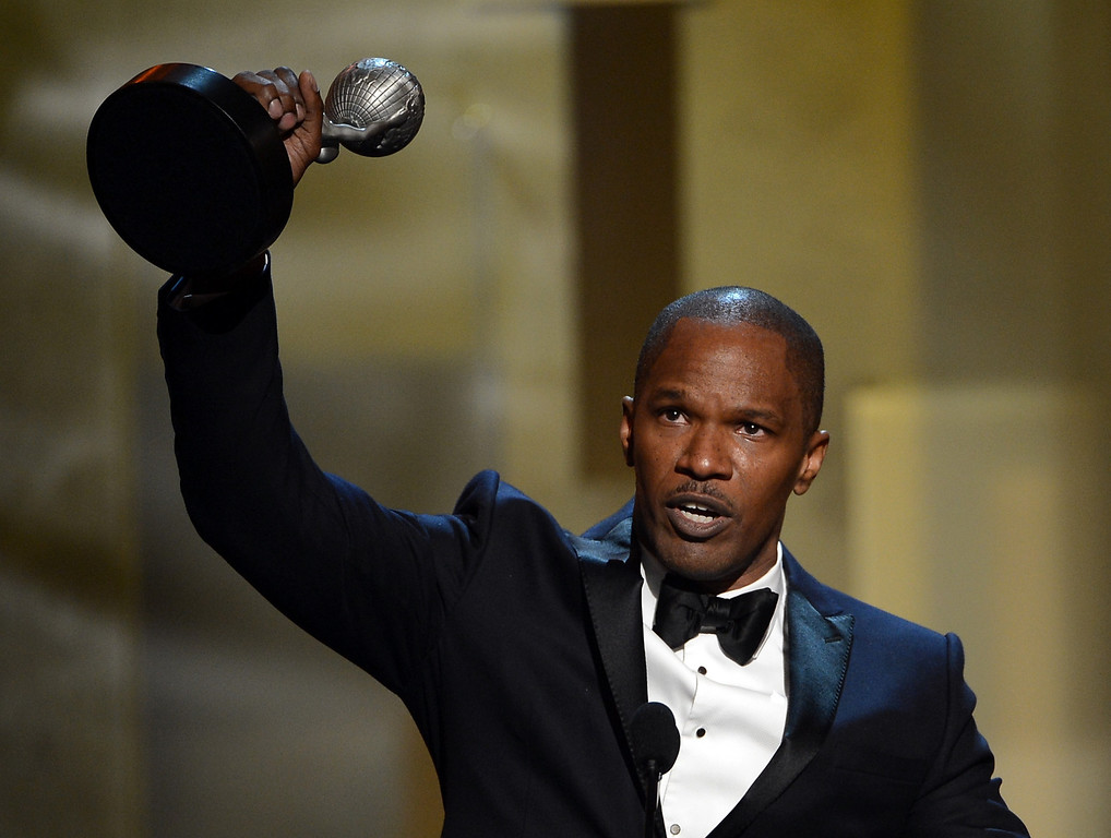 Description of . LOS ANGELES, CA - FEBRUARY 01:  Actor Jamie Foxx accepts Entertainer of the Year award onstage during the 44th NAACP Image Awards at The Shrine Auditorium on February 1, 2013 in Los Angeles, California.  (Photo by Kevin Winter/Getty Images for NAACP Image Awards)