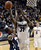 University of Colorado's Jeremy Adams takes a shot over Gabe Rogers during a game against Northern Arizona on Friday, Dec. 21, at the Coors Event Center on the CU campus in Boulder.  (Jeremy Papasso/Daily Camera)